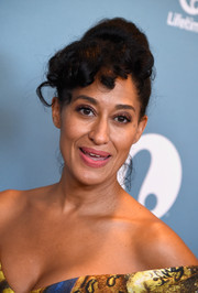 Tracee Ellis Ross swept her hair up into a high bun with curled bangs for the Power of Women Luncheon.