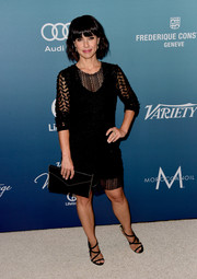 Constance Zimmer topped off her all-black ensemble with a classic envelope clutch.