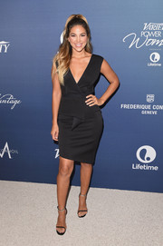 Liz Hernandez made a stylish appearance at Variety's Power of Women luncheon wearing this plunging, half-peplum LBD.