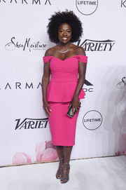 Viola Davis stood out in a bright fuchsia off-the-shoulder peplum dress by Pamella Roland during Variety's Power of Women: New York.