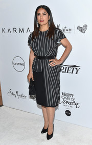 Salma Hayek went for an understated black-and-white striped dress by Balenciaga when she attended the Variety Power of Women event.