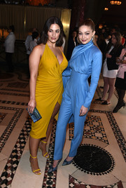Ashley Graham paired a blue Lala Lexa box clutch with a yellow wrap dress for Variety's Power of Women: New York.