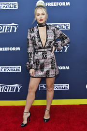 Kelli Berglund sealed off her look with black ankle-strap peep-toes.