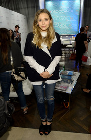 Elizabeth Olsen hid her figure under a baggy black-and-white blazer when she visited the Variety Studio.