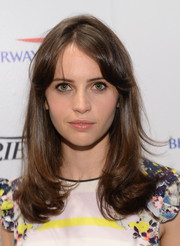 Felicity Jones wore her hair down with wavy ends and flipped bangs when she visited the Variety Studio.