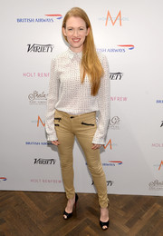 Mireille Enos posed for a shot at the Toronto International Film Festival wearing a dotted button down top and a pair of nude skinny pants.