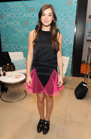 Hailee Steinfeld contrasted her girly dress with masculine-chic leather slip-on shoes by Sandro.