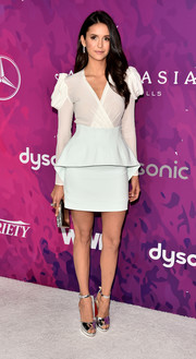 Nina Dobrev added extra shine with a silver box clutch by Judith Leiber.
