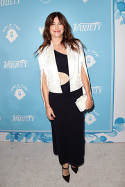 Kathryn Hahn layered a cropped white jacket over an asymmetrical maxi dress for the Variety and Women in Film pre-Emmy celebration.