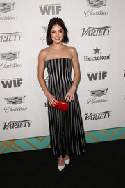 Lucy Hale punctuated her monochrome dress with a red hard-case clutch.