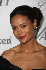 Thandie Newton finished off her look with an elegant swipe of red lipstick.