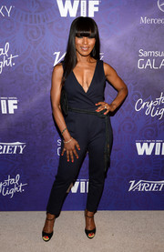 Angela Bassett teamed her chic jumpsuit with simple black ankle-strap peep-toes.