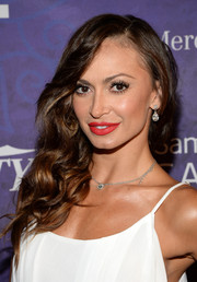 Karina Smirnoff swiped on some vibrant red lipstick for a splash of color to her white outfit.