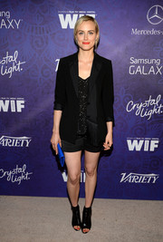 Taylor Schilling finished off her look in edgy style with a pair of black open-toe booties.
