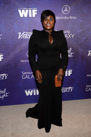 Danielle Brooks added some brightness to her look with an orange snakeskin clutch.