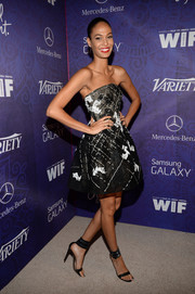Joan Smalls attended the Variety and Women in Film Emmy nominee celebration looking ultra girly in a monochrome strapless dress by Monique Lhuillier.