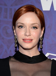 Christina Hendricks styled her simple updo with a chunky pair of dangling chain earrings.