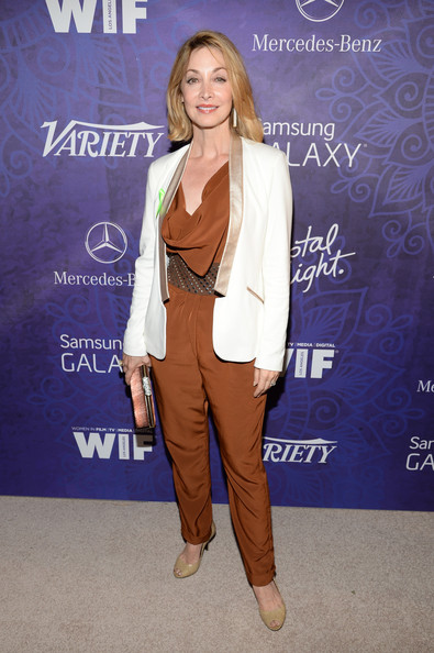 Sharon Lawrence layered a white and gold blazer over a rust-colored jumpsuit for the Variety and Women in Film Emmy nominee celebration.
