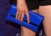 Taylor Schilling accessorized with a DVF envelope clutch in a gorgeous shade of blue at the Variety and Women In Film Emmy nominees celebration.