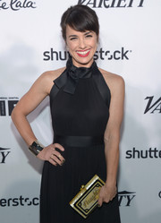 Constance Zimmer attended the Variety and Women in Film pre-Emmy celebration carrying a cheeky gold clutch by Emm Kuo.