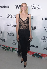 Jaime King wore her dress with a pair of black pants that not only toned down the sexiness but also made the look more interesting!