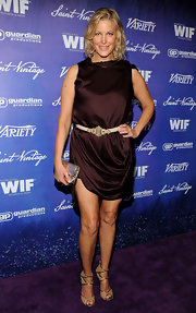 Anna Gunn was not afraid to show a little leg in this drapey chocolate brown mini dress.