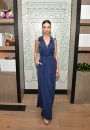 Angela Sarafyan donned a navy maxi wrap dress for the launch of Farmacy Kitchen Cookbook.