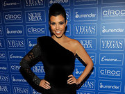 Kourtney paired her velvet ensemble with a teased modern ponytail and bold lashes.