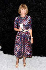 Anna Wintour chose a lovely square-print dress for the Vera Wang fashion show.