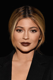 Kylie Jenner coated her famous pout a chocolate hue.