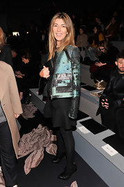 Nina Garcia wore stylish black ankle boots with her LBD and jacket when she attended the Vera Wang Fall 2013 fashion show.