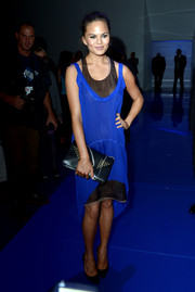 Chrissy Teigen looked chic and airy in a cobalt fishtail dress during the Vera Wang fashion show.
