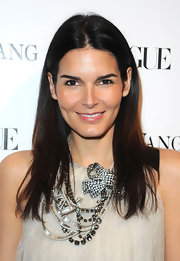 Actress Angie Harmon showed off a decadent silver and gemstone statement necklace while attending the Vera Wang store launch.