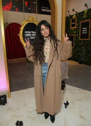 Camila Cabello bundled up in a long tan coat by Max Mara for a Q&A in Los Angeles.