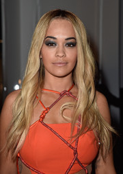 For her beauty look, Rita Ora went goth with heavy gray eyeshadow.