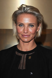 Cameron Diaz attended the Versace fashion show wearing shiny mauve lipstick.