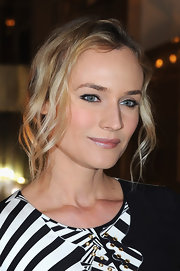 Diane Kruger wore her hair in a casual updo with soft spiral curls during the Versace fashion show in Paris.