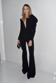 Elena Perminova showed her unique style with this black two-piece, consisting of an asymmetrical jacket and flared pants, at the Versace Haute Couture fashion show.