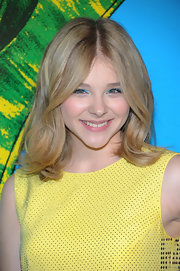 Chloe Moretz wore bright turquoise liner swept across her lids at the Versace for H&M fashion event.