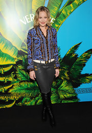 Abbie Cornish embraced prints at the Versace for H&M launch in a floral and animal print button-down top.