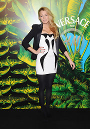 Blake Lively was chic in black and white at the Versace for H&M event in black tights and black suede ankle boots.
