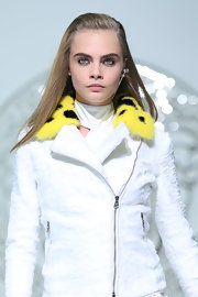 Cara Delevingne look sleek with her hair half-up for the Versace fashion show.