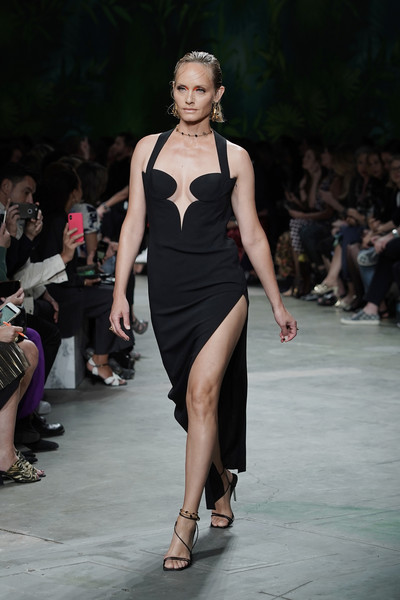 Amber Valletta looked ageless in a plunging black halter dress at the Versace Spring 2020 show.