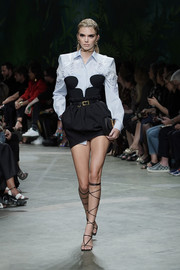 Kendall Jenner rocked a strapless LBD with a dangerously low neckline at the Versace Spring 2020 show.