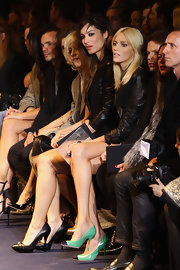 Anja Rubik's green and black cap-toes pumps stood out against a crowd of dark outfits at the Versace fashion show.