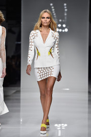 Natasha Poly modeled this multi-cutout white two-piece at the Atelier Versace fashion show. Who knew a skirt suit could be this sexy?