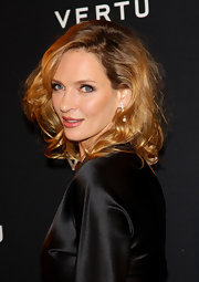 Uma Thurman wore her long hair in a sexy halo of messy curls at the Vertu global launch of the Constellation in Milan.