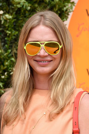 Jodie Kidd attende the Veuve Clicquot Gold Cup Final rocking a pair of yellow-rimmed, mirrored aviators.
