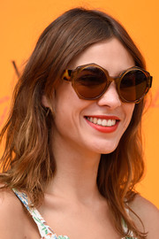 Alexa Chung accessorized with a pair of octagonal sunglasses when she attended the Veuve Clicquot Gold Cup Final.