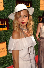Rachel Zoe added a pop of vibrant ruby red to her all-white ensemble at the Veuve Clicquot Polo Classic. She wore a super-saturated lipstick that created the perfect pout.